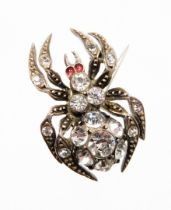 A late Victorian spider brooch, the body set with various paste stones, in a white metal setting, st
