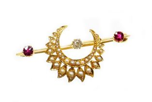 An Eastern inspired bar brooch, set with diamond, ruby and applied crescent moon and flower set seed