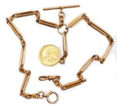 A 9ct gold watch chain, with clip T bar and applied George V full gold sovereign dated 1912, in a 9c