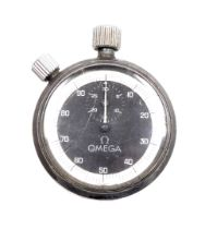 An Omega steel cased stop watch, the black dial with white outer border, inscribed to back E M G A S