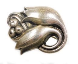 A Georg Jensen Danish silver brooch, of two flower buds and berries, bearing UK hallmark and numbere