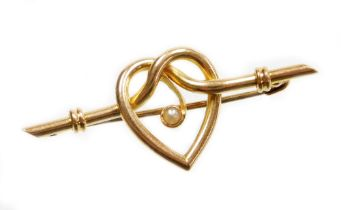 A heart shaped bar brooch, the central heart section with single applied seed pearl, on a ribbed bar