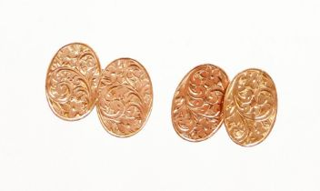 A pair of Edward VII 9ct gold cufflinks, each engine turned decorated with scrolls to both sides, ch