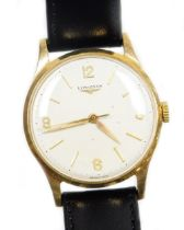 A Longines 9ct gold gentleman's wristwatch, with a cream coloured dial, in a 9ct gold casing, on a l