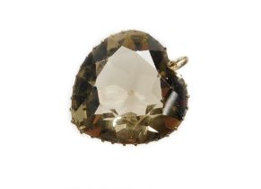 A smoky quartz heart shaped pendant, in a pierced design basket frame, yellow metal unmarked, 3cm x
