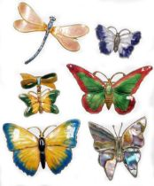 A group of enamelled brooches, to include a small purple butterfly brooch, white metal, stamped ster