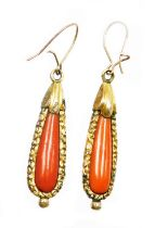 A pair of early to mid 20thC coral drop earrings, each with tear drop shaped coral centre and a gold