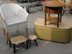 A gold Lloyd Loom linen basket, small stool, milking stool and a side table, and a Lloyd Loom style