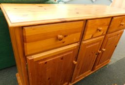 A pine sideboard, the top with three drawers above three doors, 82cm high, 126cm wide, 42cm diameter
