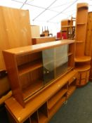 A Schrieber low sideboard, a bookcase with glass sliding doors, and a Nathan freestanding corner cab