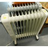 Two oil filled electric heaters, Futura and Blyss.