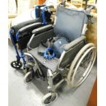 Two wheelchairs.