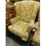 A Sherborne wing back armchair, in floral fabric on cabriole legs. The upholstery in this lot does n