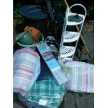 A quantity of garden related items, to include deck chairs, plant pots, seat covers, rake, lanterns,