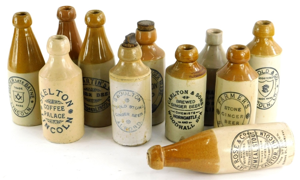 A collection of Lincoln related stoneware ginger bottles, to include Skelton, Draper, Claxton, Rose,