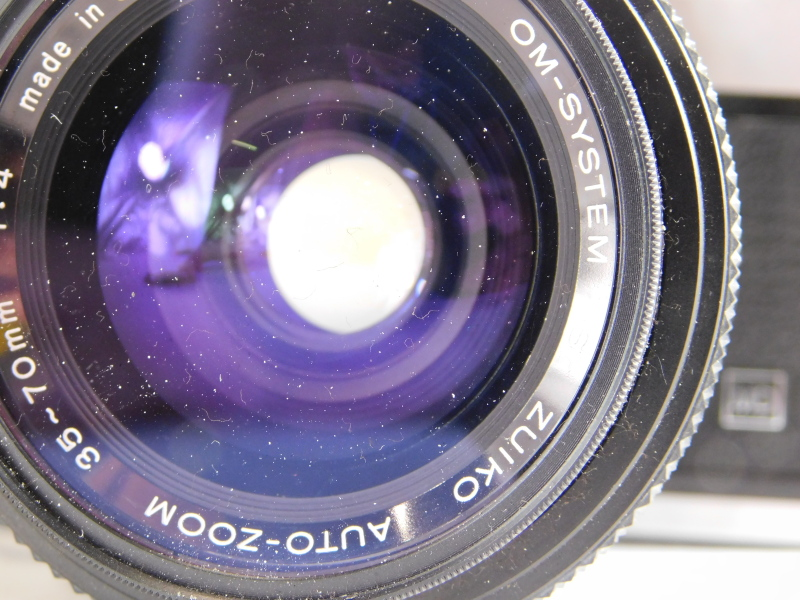 An Olympus OM2 camera, with lens, and an electronic flash. (2) - Image 2 of 2