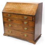 A George III oak bureau, the fall enclosing a vacant interior above four graduated drawers, each
