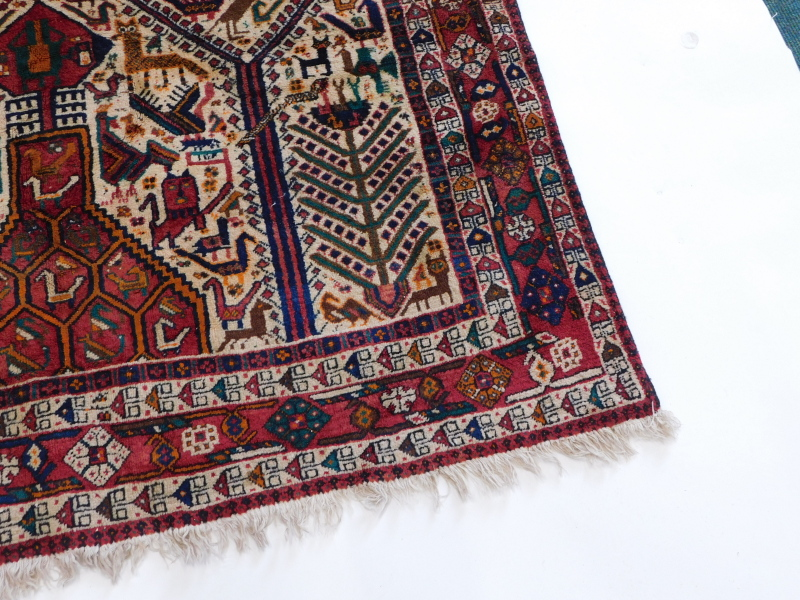 An Indian rug, with an all over design of animals, to include lions, cat like animals, birds, - Image 2 of 3