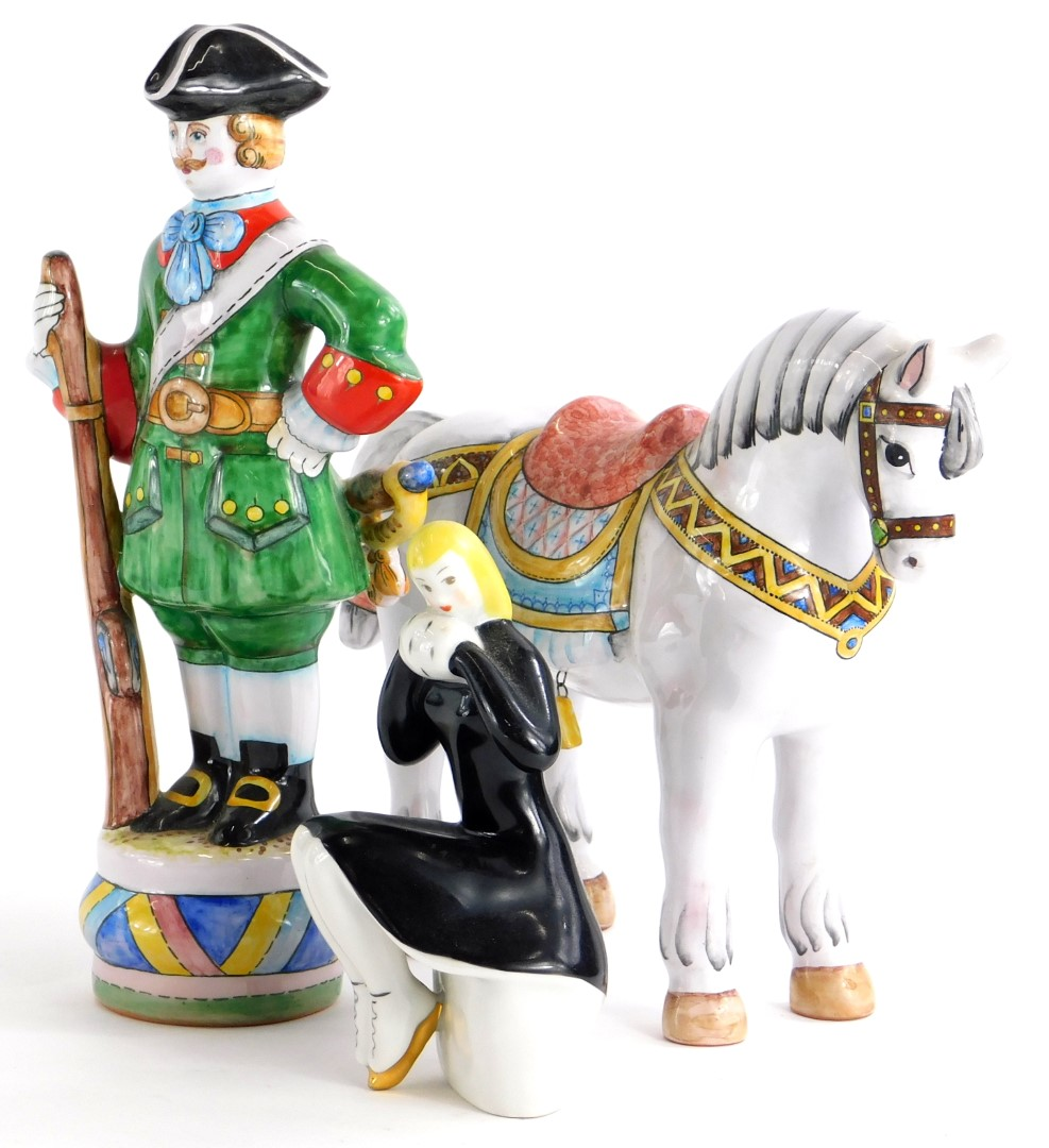 Two late 20thC Russian ceramic figures, modelled in the form of a horse and soldier, and a Russian