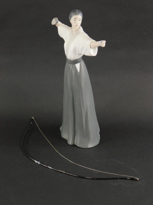 A Lladro matte glazed porcelain figure of a Japanese female archer, impressed marks to underside - Image 2 of 3