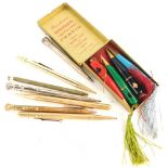 A set of four Burnham's bridge propelling pencils, and various gold plated and other propelling