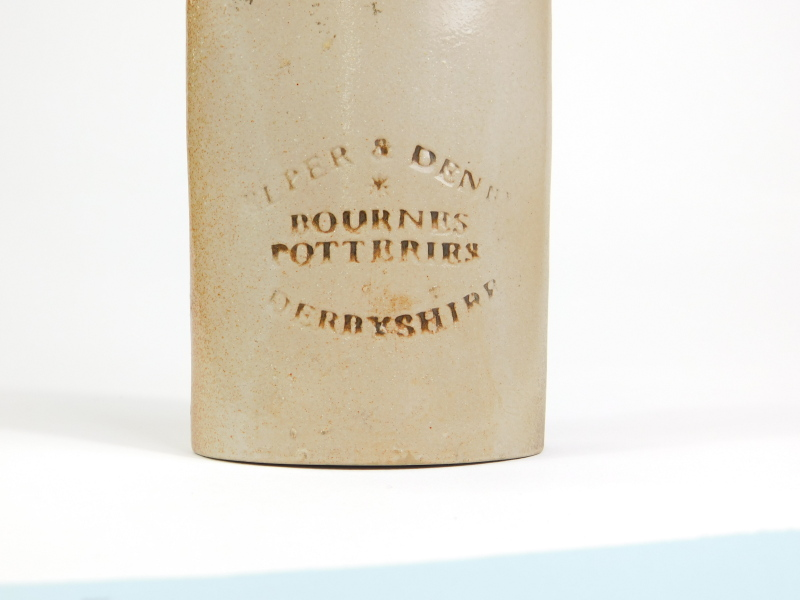 A 19thC Brougham stoneware reform cordial flask, modelled holding the second Magna Carta, impress - Image 2 of 4