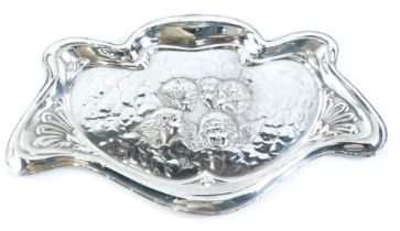 An Edwardian silver tray, decorated in Art Nouveau style with 'Reynolds Angels', the shaped border