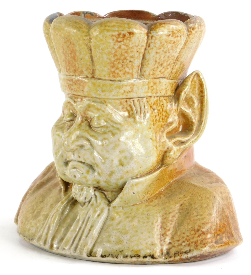 A Victorian stoneware tobacco jar, modelled in the form of a goblin type figure, wearing a hat or