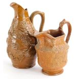 A 19thC stoneware silver shaped cream jug, decorated with roundel's etc., 14cm high and a