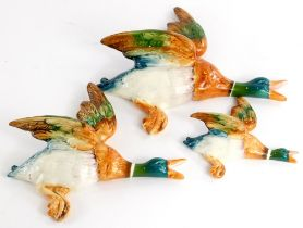 A graduated set of three Beswick flying ducks, the largest 26cm long.