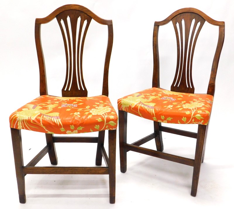 A pair of 19thC elm dining chairs, each with a pierced splat and a padded seat, adapted.