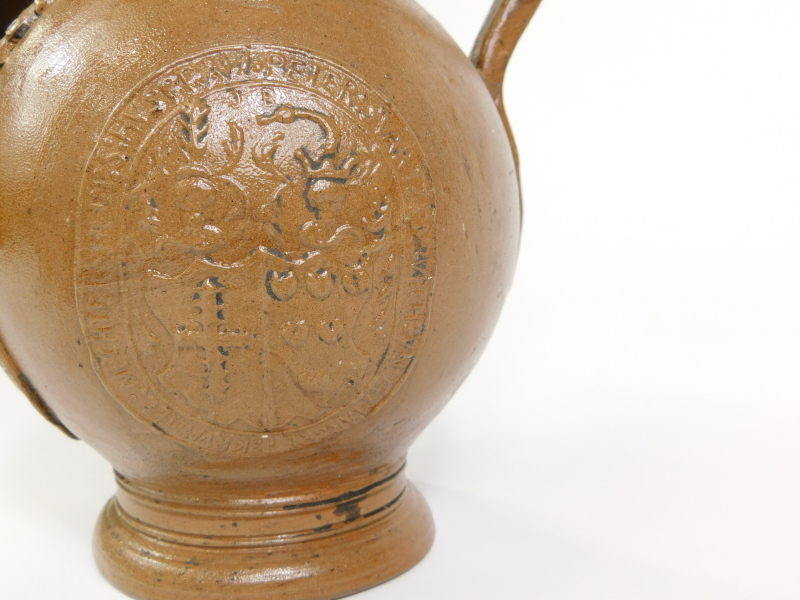 A stoneware Bellarmine jug, decorated with a bearded mask and with three continental crests, - Image 3 of 5