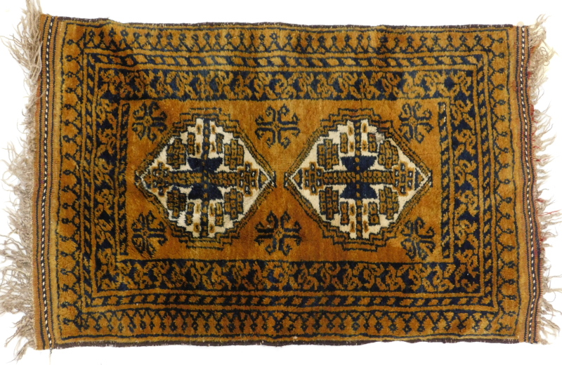 An Afghan rug, with a design of two medallions, on a brown ground, 60cm x 94cm.