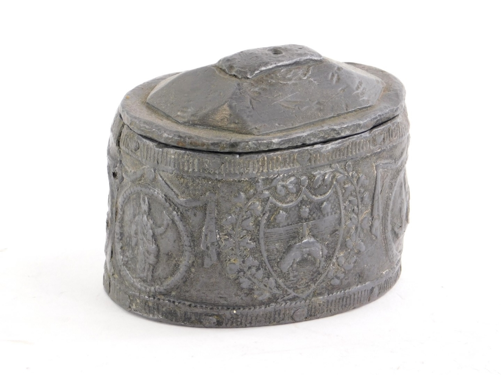 A 19thC lead tobacco jar, decorated with various crests, cover, etc.