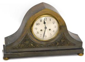 An unusual early 20thC patinated brass mantel clock, of arched form with two panels, each