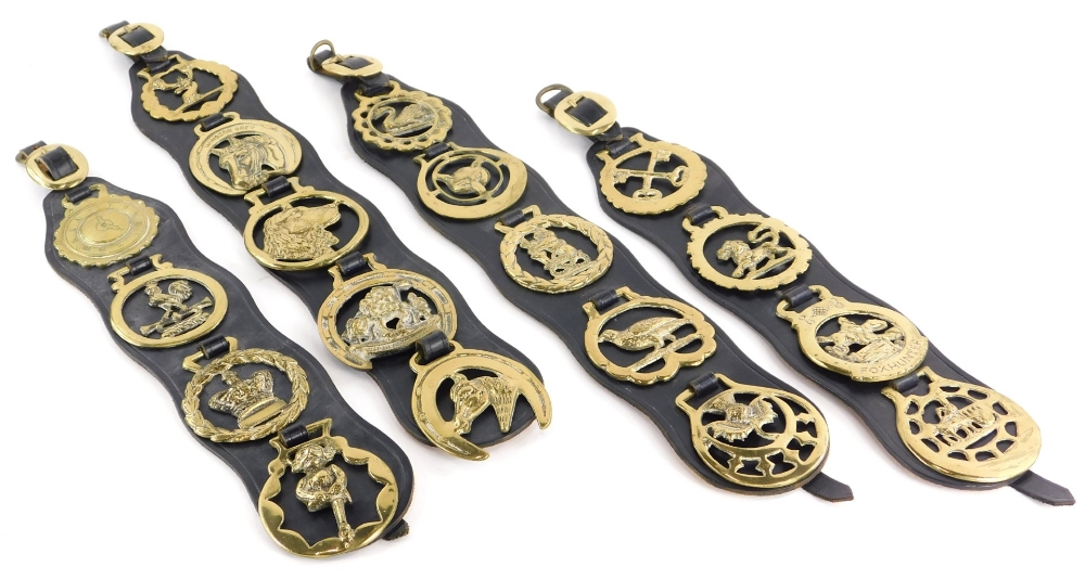 Various vintage horse brasses, to include Lincoln Imp, a crown and various Martingales.