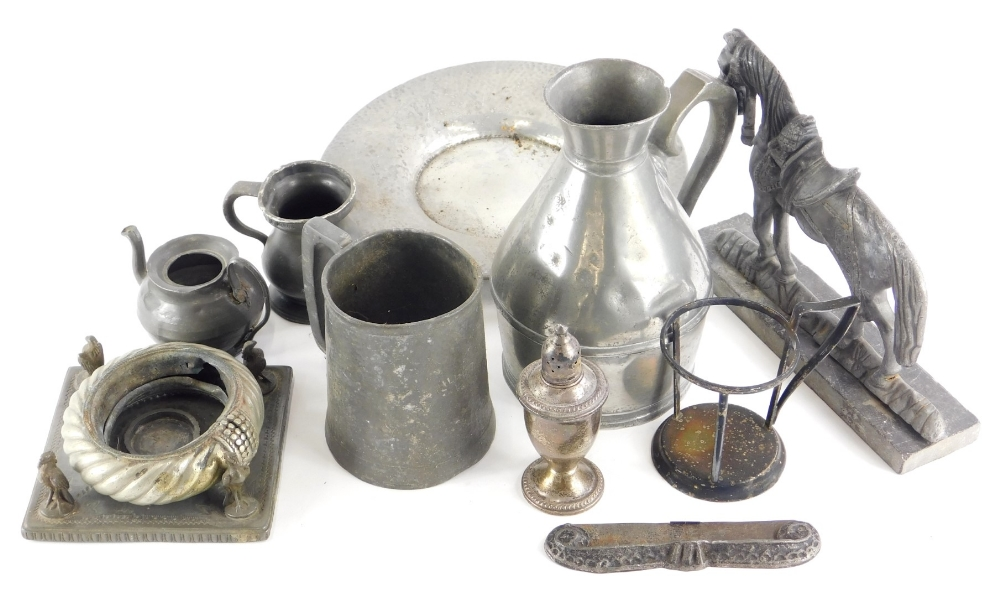 A collection of metalware, to include a pewter doorstop, hammered pewter plate, items of silver