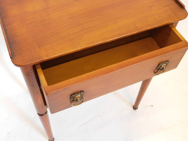 A French fruitwood bedside table, with a raised gallery, above two drawers, each with lion mask - Image 2 of 2