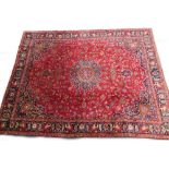 A large Persian Meshed type carpet, with a central medallion, surrounded by an elaborate design to
