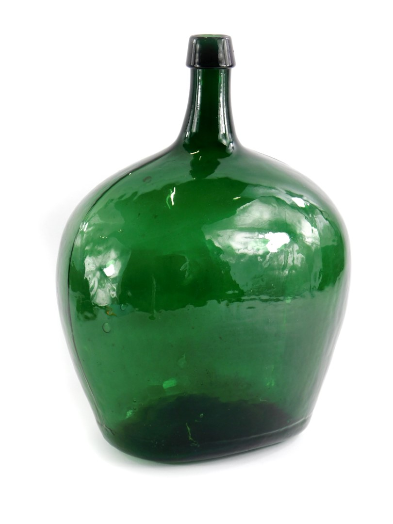 A green glass demijohn, unmarked 40cm high.