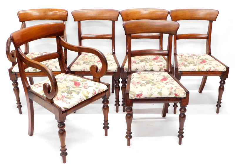 A set of six early Victorian mahogany dining chairs, each with a bar back, a drop in seat and turned