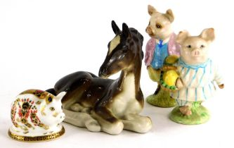 A Beswick ceramic model of Pigling Bland and Little Pig Robinson, brown back stamp, a Royal Crown