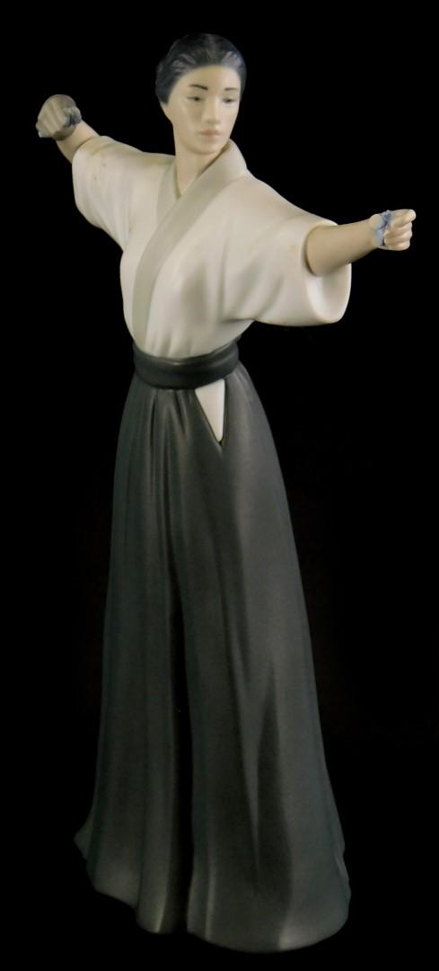 A Lladro matte glazed porcelain figure of a Japanese female archer, impressed marks to underside