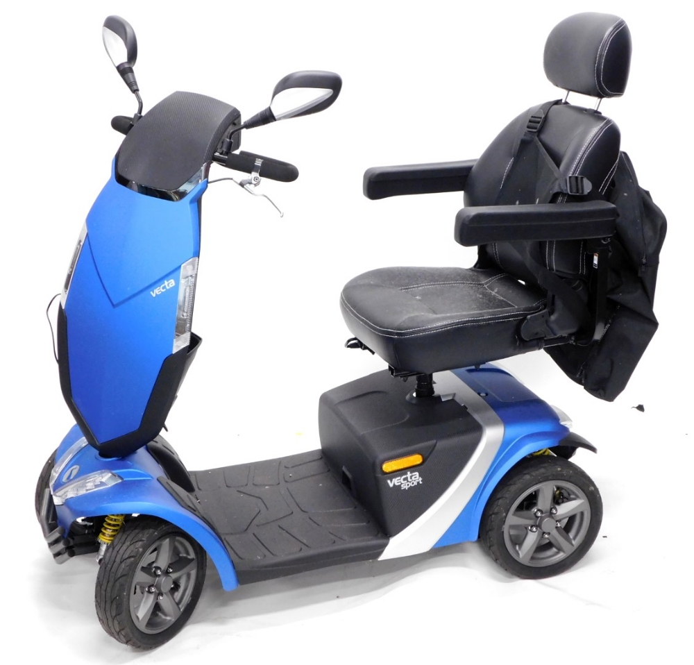 A Vecta mobility scooter, in blue with charger, back pack etc.