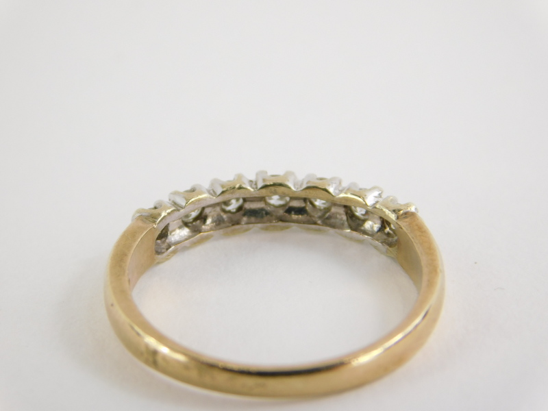 A 9ct gold half hoop eternity ring, set with seven round brilliant cut diamonds, in claw white - Image 2 of 2