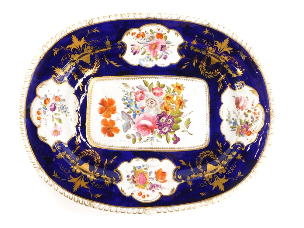An early 19thC Derby porcelain meat dish, painted with flower sprays on a cobalt blue ground, (