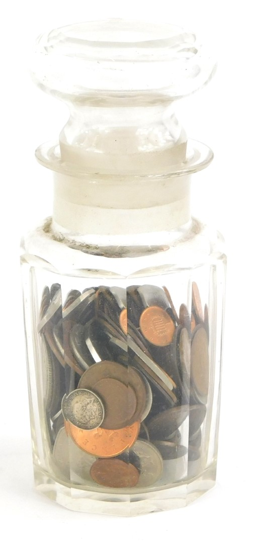 A quantity of British coins, to include a small amount of silver, and a glass jar with faceted