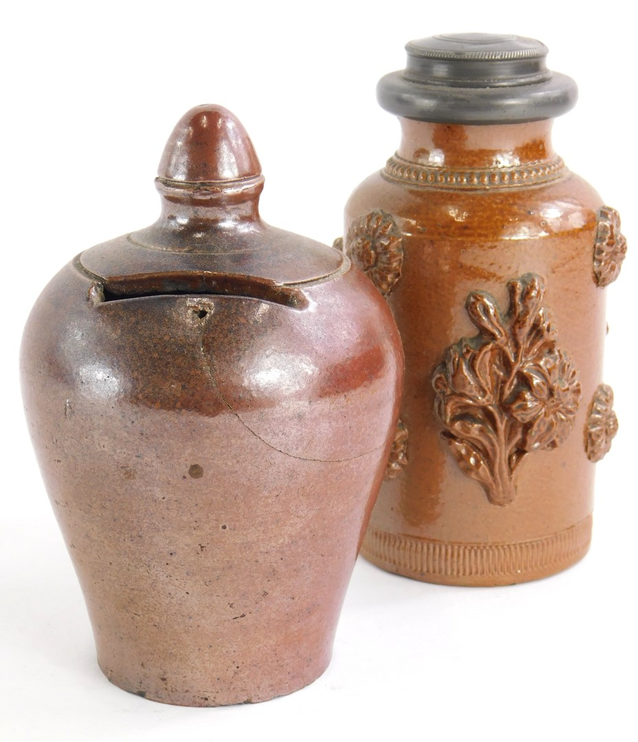 A 19thC stoneware baluster shaped money box (AF), 12cm high, and a stoneware tea caddy with pewter