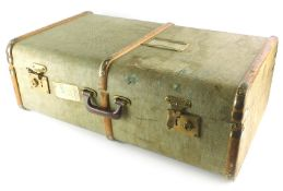 A green canvas and wooden bound suitcase or travel trunk, with brass effect metal mounts, British