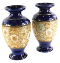 A pair of Doulton Slaters patent vases, each decorated with flowers in white and turquoise in cobalt